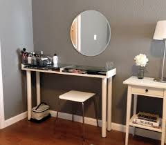 saving small spaces with narrow diy makeup vanity table with makeup storage under glass top and wooden base painted with white color plus mounted oval