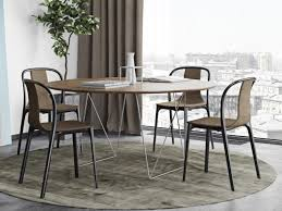 stylish row dining tables in 2 sizes with a walnut top and metal trestles legs in