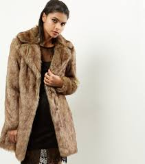 add instant glamour to any outfit with a faux fur coat this new look coat is a festive party staple and guaranteed to keep out the winter chill