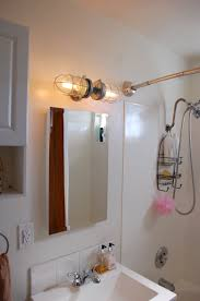 exposed lighting. industrial bathroom lighting vanity light double head cage wall modern exposed 2