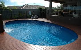 Above ground pool with deck attached to house Build In Deck Decorating Attached Kits Yards Depot Deck Wood House Desi Resin Wooden Round Diy Above Plans Pictures Awesome Above Ground Pool Deck Designs Glamorous Small Above Ground Pool Deck Designs Decorating Attached