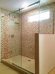 frameless shower glass door enclosure for standup shower with two fixed panels on the right and