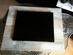 the inner aluminium frame was too shiniy so i painted it black lastly i mounted it on a wooden frame glued the electonics on the back and decorated it