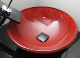 the red bowl of the bathroom sink
