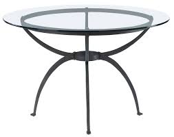 country dining table design with round flat polished glass table top and black wrought iron table