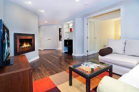dazzling shaw laminate flooring in basement modern with basement flooring next to gas fireplace alongside corner gas