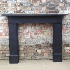 a reclaimed fire surround in plain black slate this fully refurbished surround has a simple elegant design suitable for a traditional or contemporary