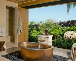 ... gorgeous outdoor bathroom with brass bathtub and natural surroundings  ...