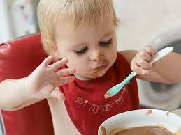 children learning to feed themselves