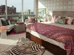 bright patterned bedroom with zebra rug and colorful coverlet