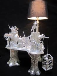 check out this crazy lamp made from an ewok village toy and appaly dipped in silver giving it a mirror finish i don t know whether to love it or