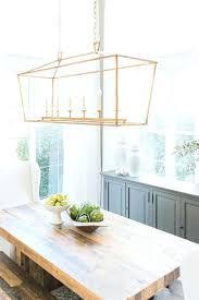 chandelier over dining table linear dining room lighting brass rectangular chandelier over reclaimed wood table lantern