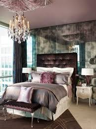 Trendy purple themed bedroom photo in Dallas with gray walls