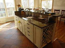 Hard Maple Wood Colonial Raised Door Kitchen Island With Wine Rack  Backsplash Shaped Tile Stone Sink Faucet Lighting Flooring Wood Countertops