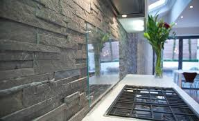 natural stacked stone backsplash made with norstone series charcoal ledgestone panel system with frosted glass guard
