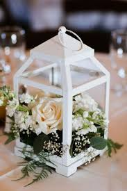 Lantern wedding centerpiece Diy White Lantern With Fresh Neutral Blooms Can Become Great Base For Any Wedding Centerpiece Weddingomania 31 Chic Lantern Wedding Centerpieces Youll Like Weddingomania