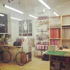 our west end sewing studio is fashioned with 4 large cutting tables a spacious change room and a large retail area with fabrics from poplar designers such