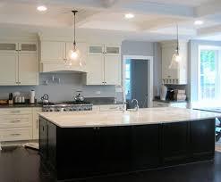 white shaker kitchen large dark island modern kitchen