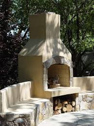 36 stone age stucco fireplace with seatwalls