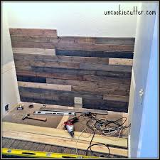 i created this mixed wood wall with wood paneling from leftover stain and