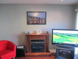mounting flat screen above electric fireplace are you mounting tv above fireplace mounting flat screen above