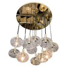 custom twelve globe chandelier with brass canopy for