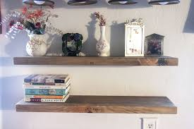 two floating shelves brown stain level front view