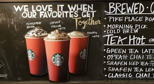 starbucks coffee menu 2015. Perfect Menu Red Paper Cups Are Featured On A Chalkboard Menu Behind The Counter At Starbucks  Coffee On Coffee Menu 2015 H