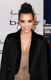 kim kardashian was on hand at the launch of her bebe jewelry launch in new york gold pendant