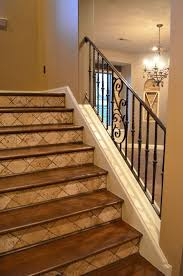 iron railing tumbled tile risers and stained wood treads