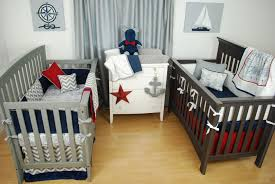 red white and blue crib bedding for twins in a nautical nursery