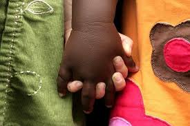 Image result for black and white children holding hands