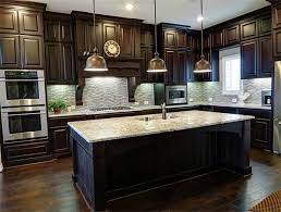 dark kitchen cabinets with dark hardwood flooring