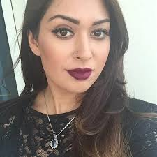 nilo haq taking a selfie with maroon lipstick