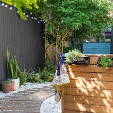 use decking to create a pathway through your garden perhaps to a more solid decked area this boardwalk style route is given even more of a seaside feel
