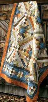 SMOKEY RIVER PATTERN - Marbled prints add sparkle and interest ... & SMOKEY RIVER PATTERN - Marbled prints add sparkle and interest. Traditional  roots and modern appeal combine in this x pieced quilt. Adamdwight.com