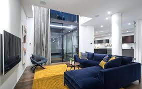 navy and white living room contemporary with yellow area rug rugs furniture fair greenville nc contem