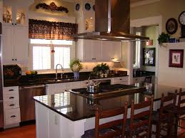 white wooden kitchen cabinet and stainless steel hood over black