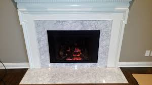 616 gas insert with times square face custom tile around the old fireplace no