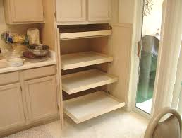 kitchen pantry cabinet after installing pull out shelves for pantry storage
