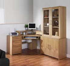 sectional cabinet with desk for computer has some storage