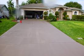 home s appearance is by painting your driveway a matching color to your home here is a driveway we painted this past week in east port st lucie fl
