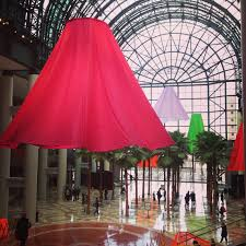heather nicol s whimsical skirt sculptures bring color and to winter garden atrium