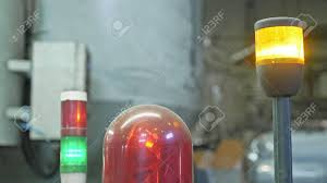 Warning Light On A Processing Machine Closeup Flashing Red Lamp