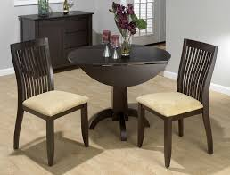 wooden black fold down dining table with round designs