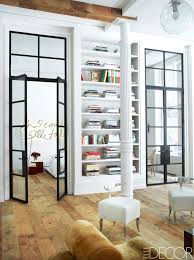 metal and glass doors to the bedroom in a manhattan loft via thouswellblog