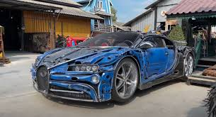 Vietnamese men make 'drivable' lamborghini and bugatti supercars out of cardboard. This Place Making Bugatti Chirons Out Of Scrap Metal Will Blow You Away Autoevolution