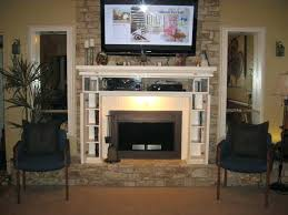 tv stand over fireplace cabinet to hide cabinet