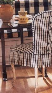 plaid slipcover with oned back and pleated skirt on dining chair