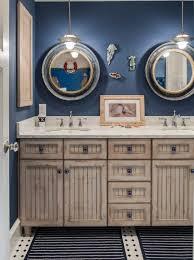 bathroom nautical themed wallpaper high gloss vanity white corner bathtub wooden laminate flooring freestanding blue mosaic